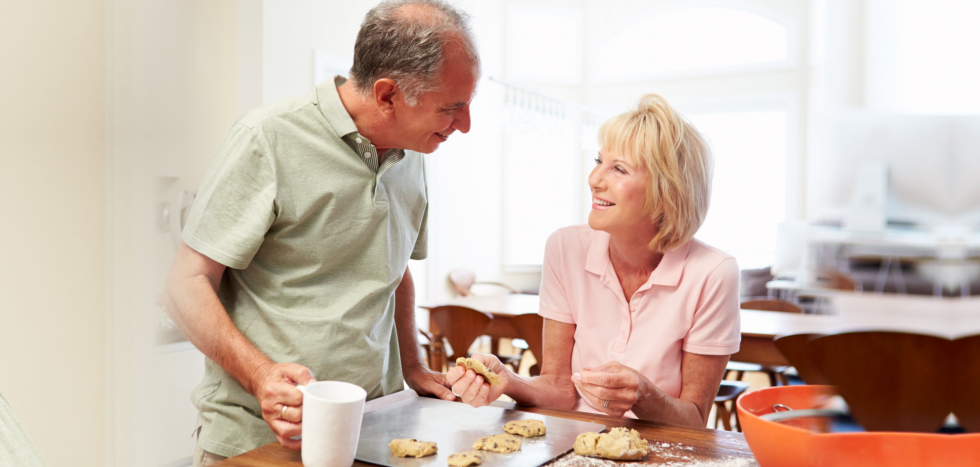 Elderly couple baking cookies
