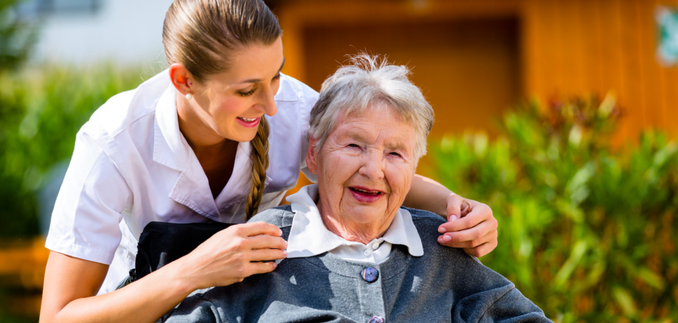 Caregiver and elderly person laughing